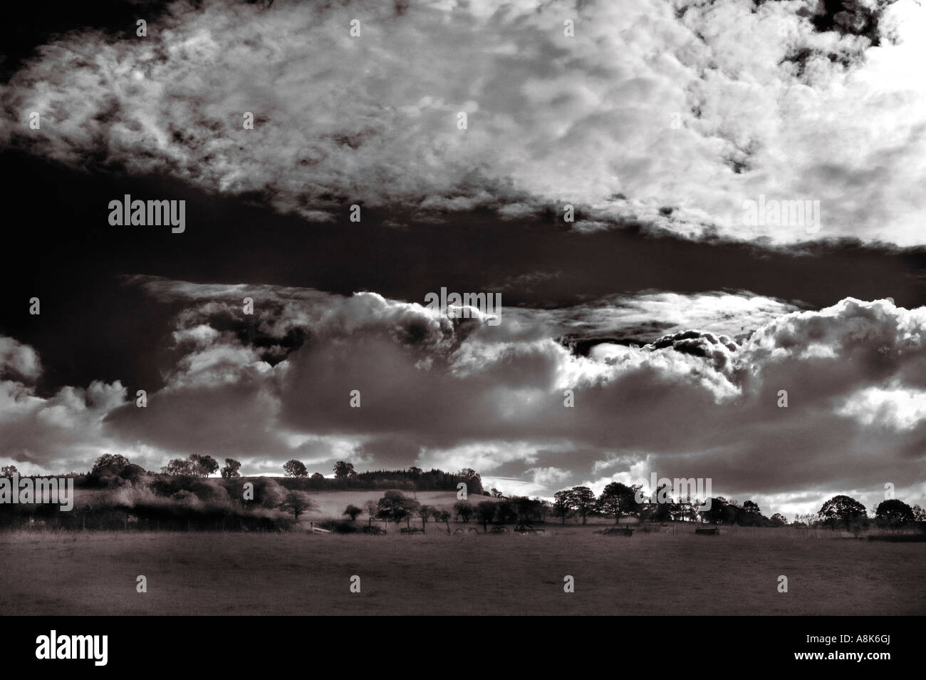 Black and White rural landscape in South Wales with a big dramatic darkening sky - Stock Image