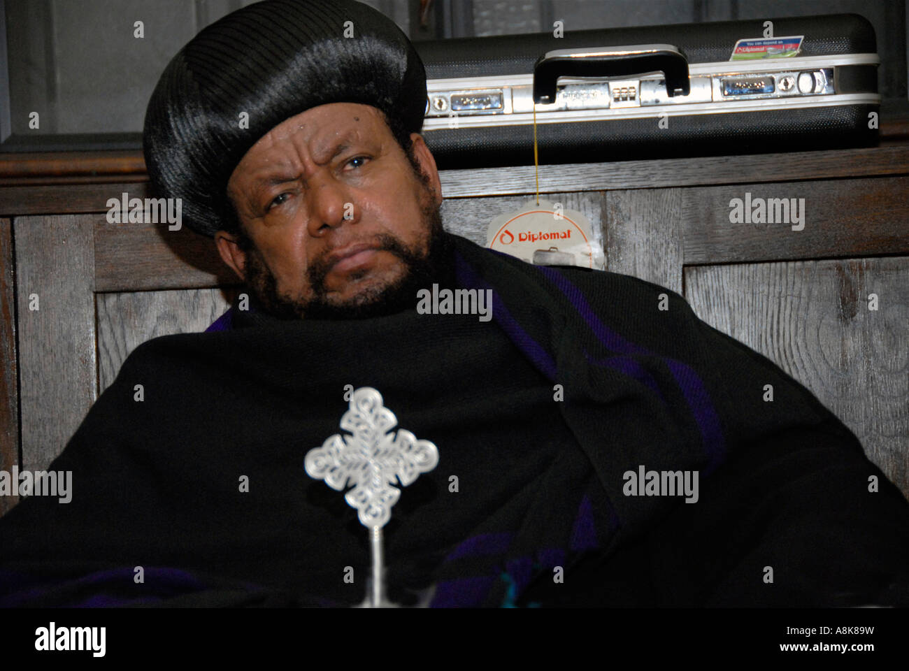 Archbishop of  Ethiopian orthodox Tewahedo Church in London eating feast - Stock Image