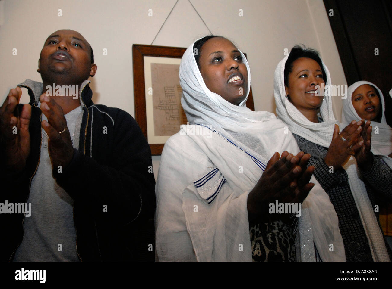 Chanting after service at Ethiopian Orthodox Tewahedo church Central London. - Stock Image