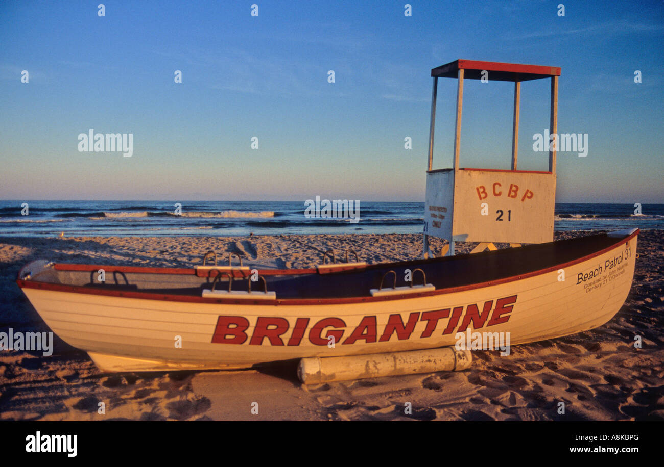 Lifeguard boat and stand at sunset at Brigantine beach - Stock Image