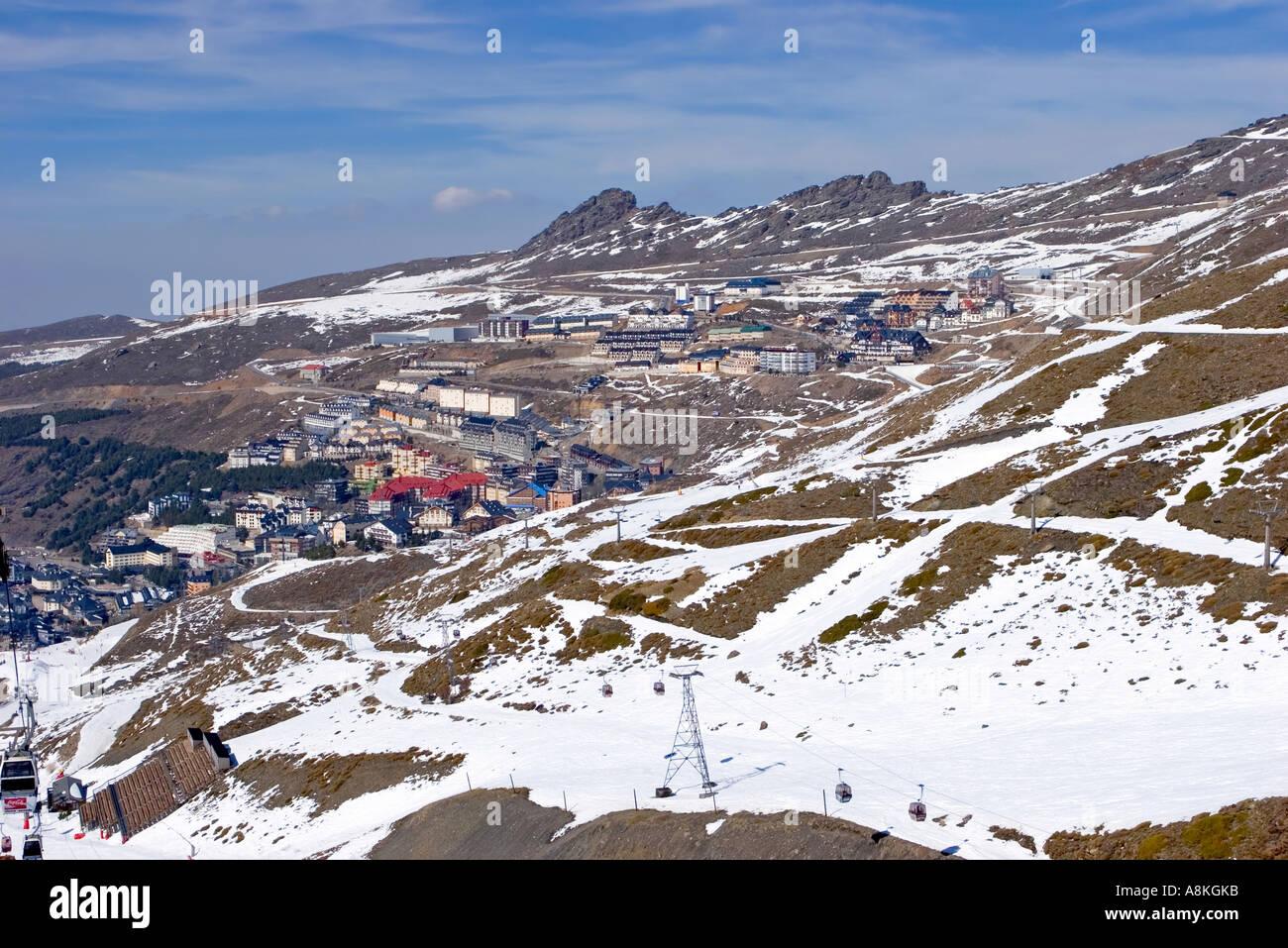 snowy ski slopes of pradollano ski resort in the sierra nevada stock