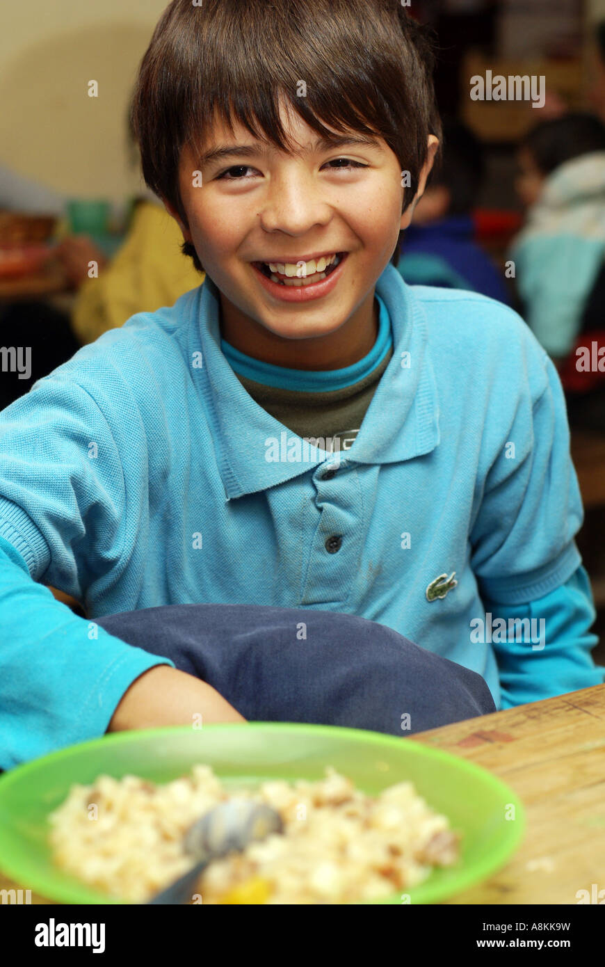 Poor boy in a soup kitchen, Cordoba, Argentine Stock Photo: 12127140 ...