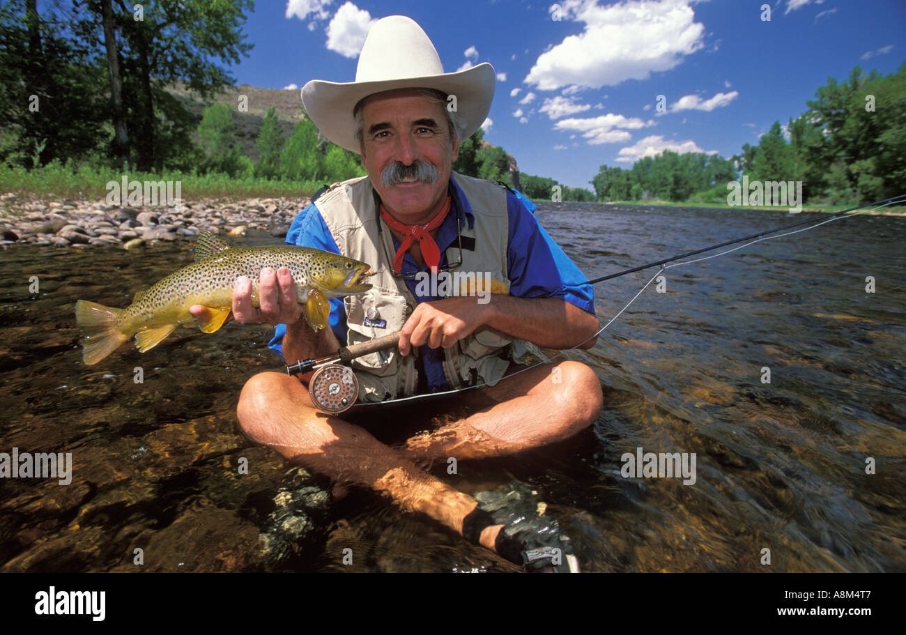 Montana Fisherman Catching A Brown Trout In The Big Hole River Stock