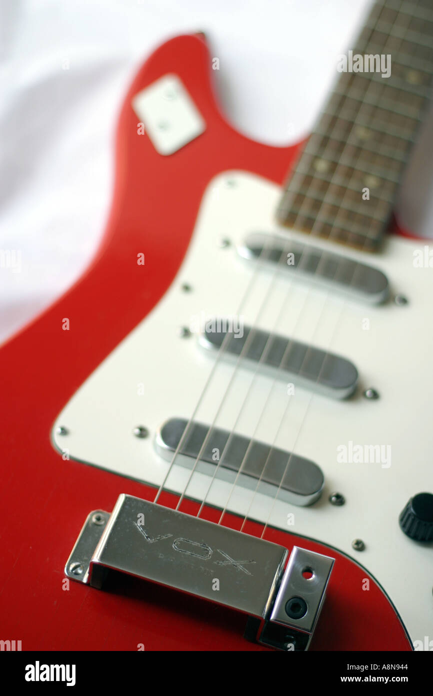 Vox Dominator guitar - classic British electric guitar in red and white, 1960s,sound of the sixties. Old vox guitar - stratocaster copy - Stock Image