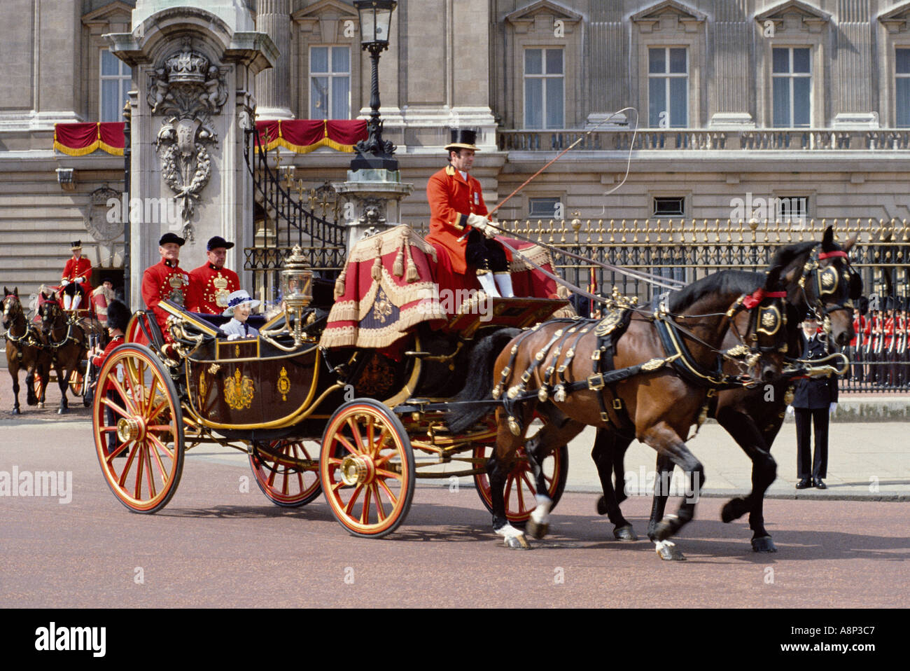 Royal carriage and Queen Elizabeth II leaving Buckingham Palace - Stock Image