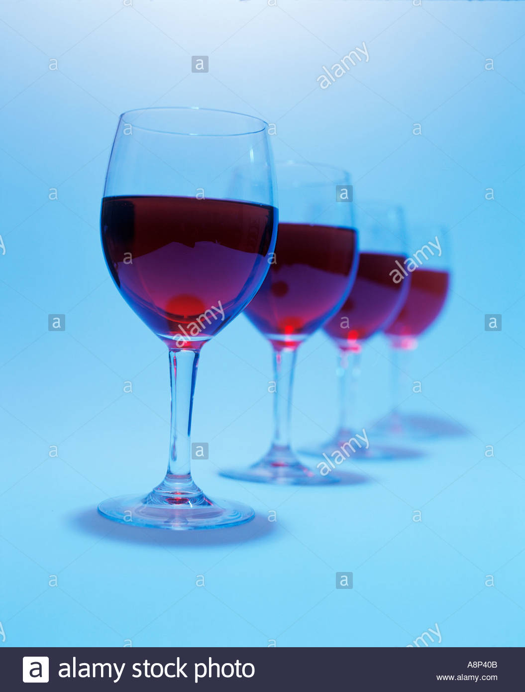four shape in photographic studio situation white background and blue wine glasses substance - Stock Image