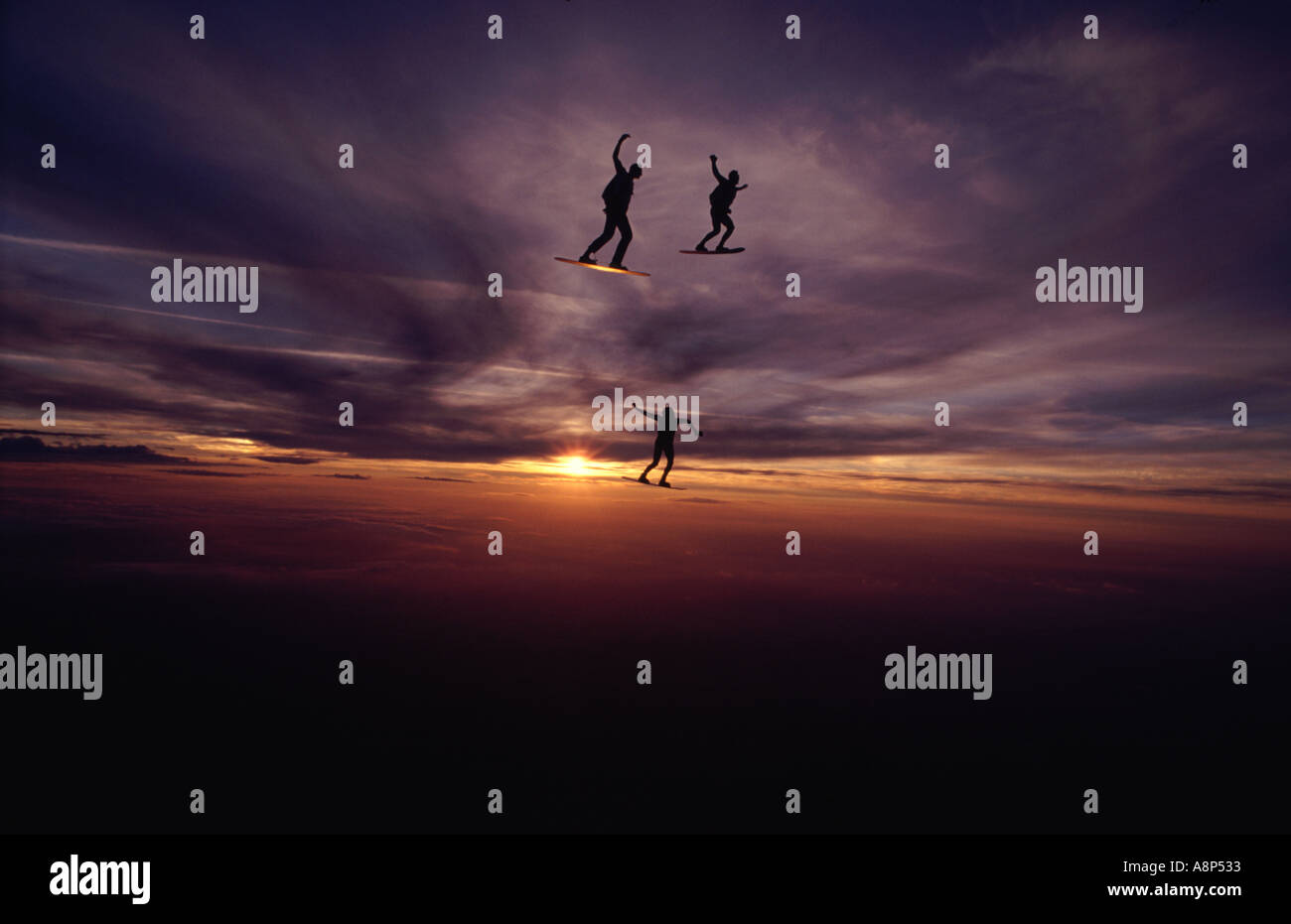 Skysurfers at sunset - Stock Image