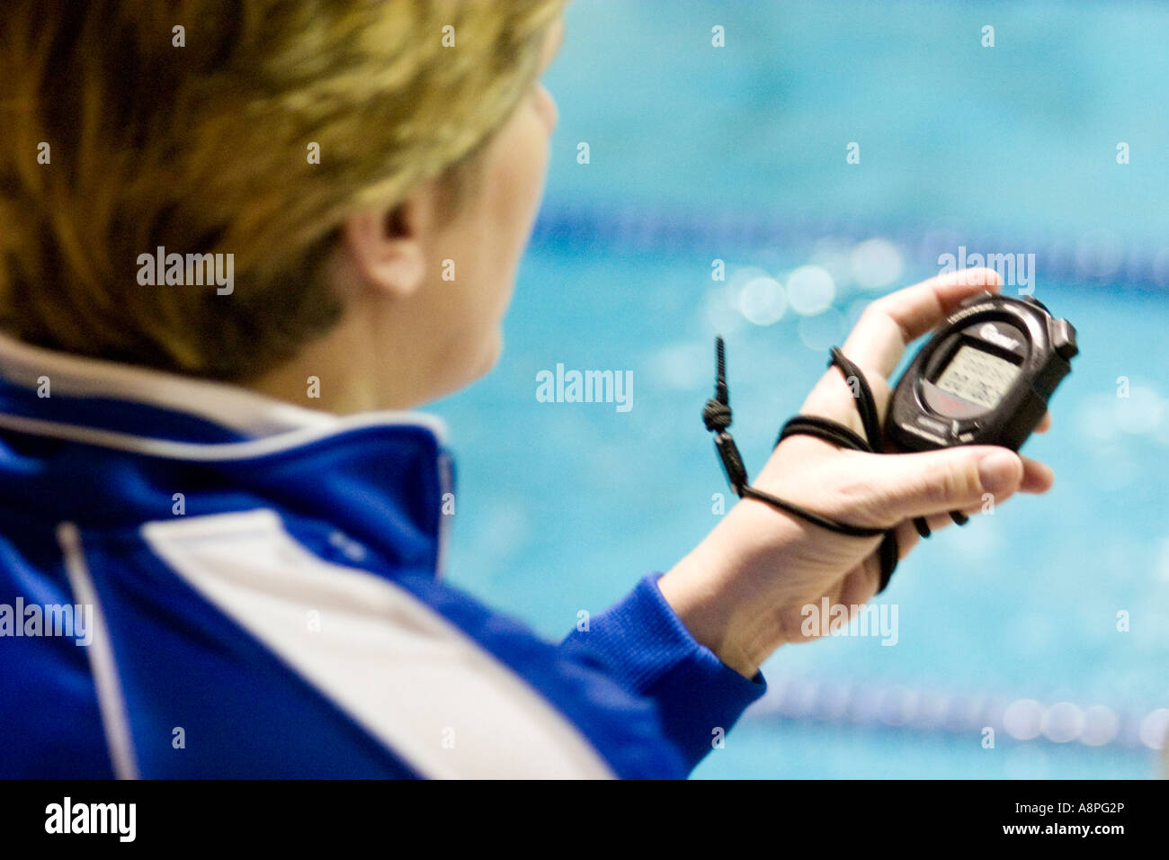 Coach timing at college swim meet. Macalester College St Paul Minnesota USA - Stock Image