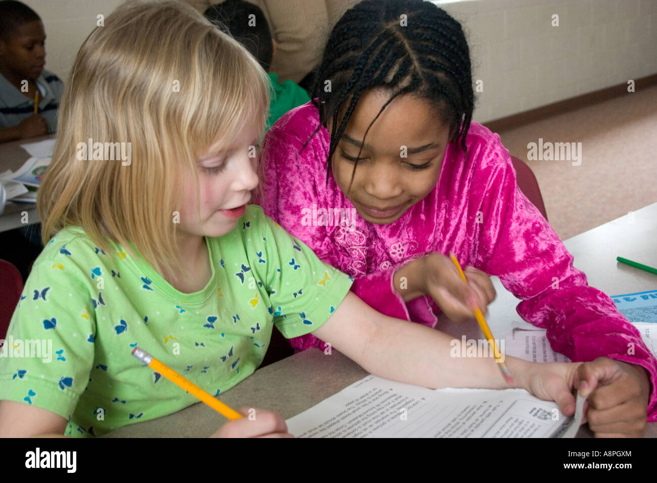 Students working on homework after school. After School Study Program. St Paul Minnesota USA - Stock Image