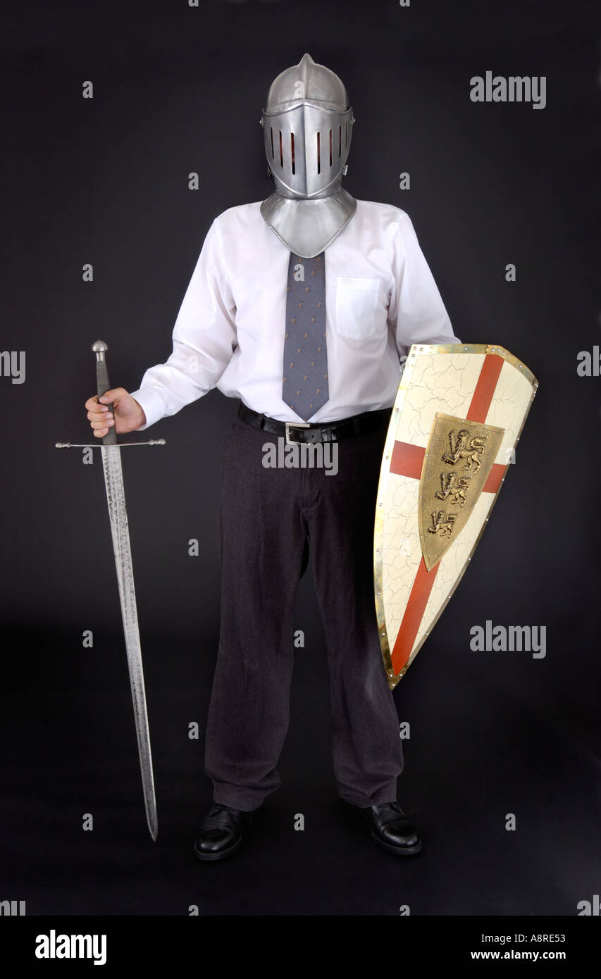 Business man with knight helmet shield and sword - Stock Image