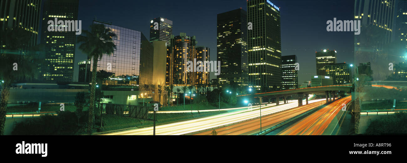 Evening view of Los Angeles skyline and freeway Los Angeles CA - Stock Image