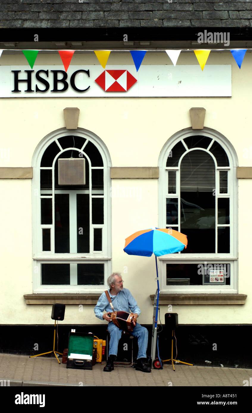 Busker Outside Bank Stock Photos & Busker Outside Bank Stock