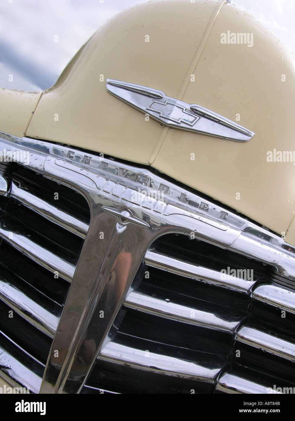 Grille of antique Chevrolet vintage collector s car Small water droplets from recent rain on parts of chrome - Stock Image