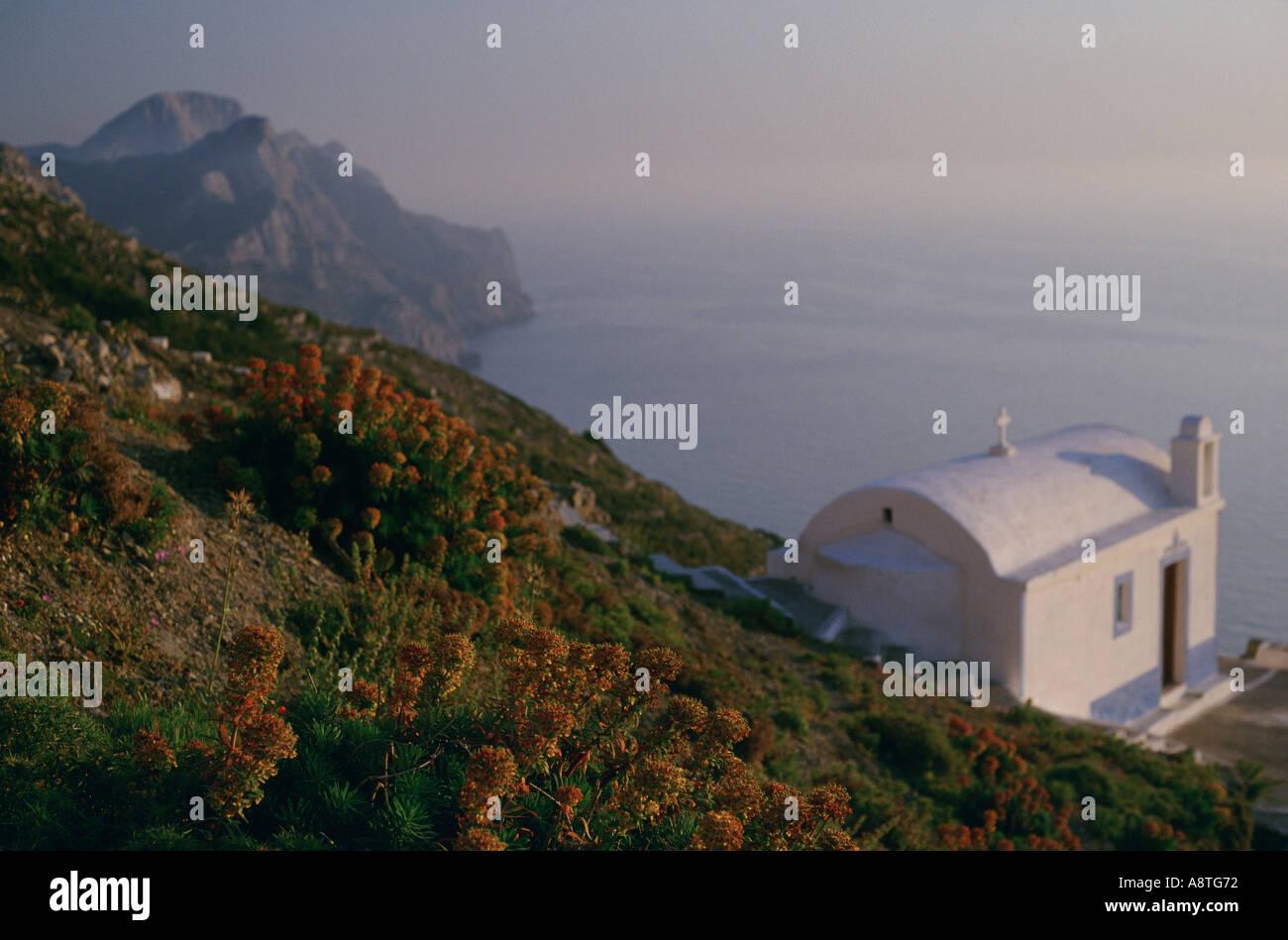 White chapel on the hillside city of Olymbos Karpathos Greece Stock Photo