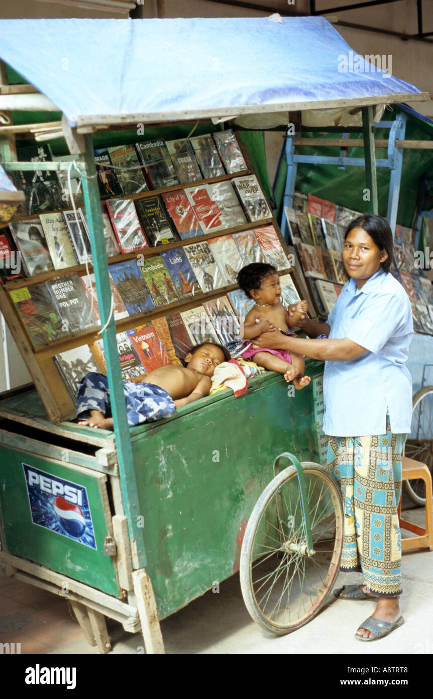 Woman book seller with her children near Pub St, Siem Reap, Cambodia - Stock Image