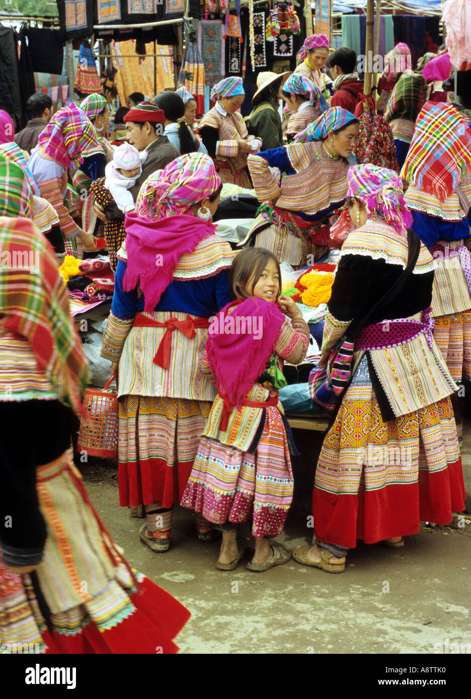 Group of traditionally dressed Flower Hmong women and a young girl at the Sunday market, Bac Ha, NW Viet Nam Stock Photo