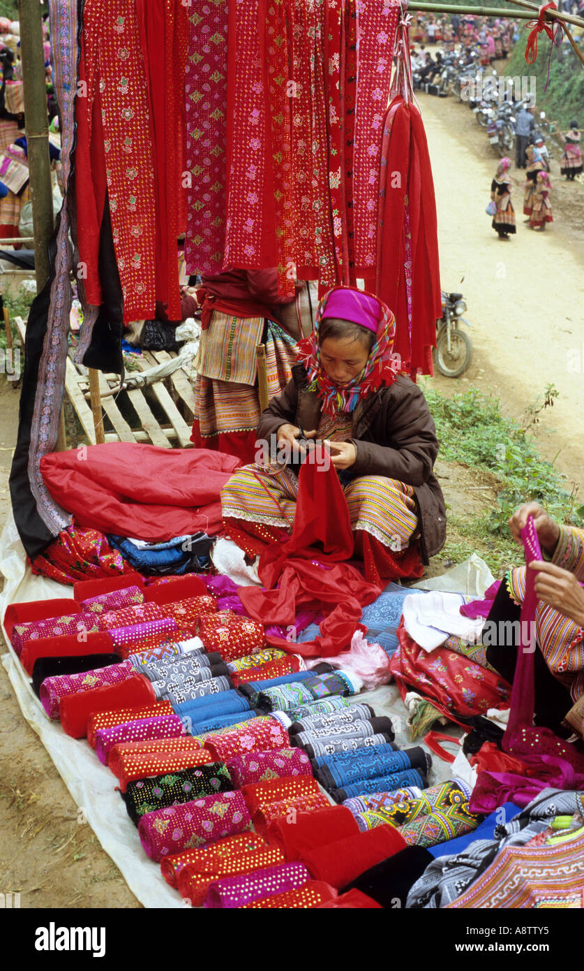 Display of brightly coloured velvet fabric for sale at a stall, at the Saturday market, Can Cau, NW Viet Nam Stock Photo