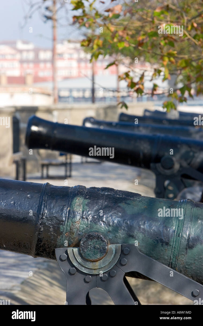 Row of original cast iron and historical cannons in Gibraltar on a sunny day - Stock Image