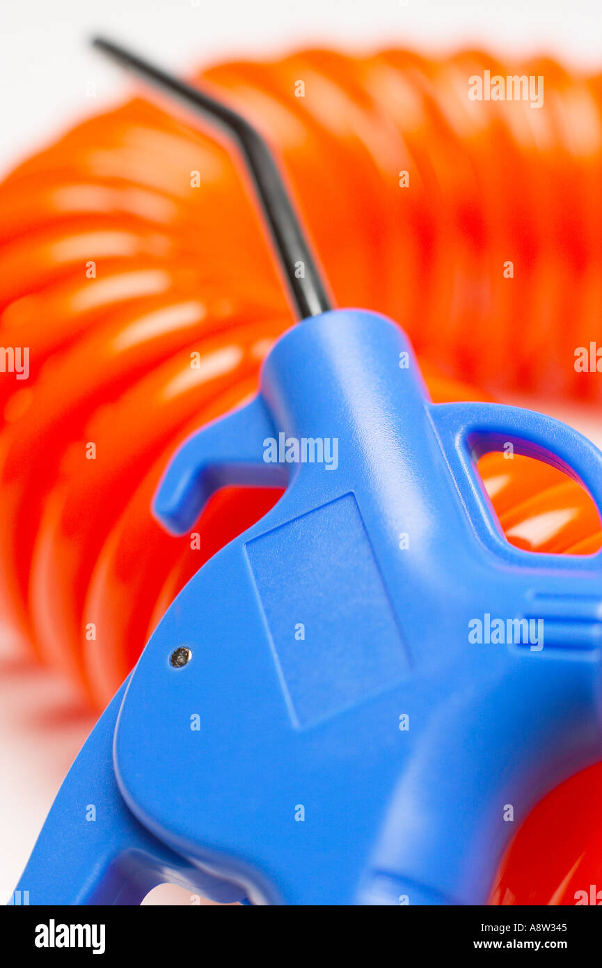 Compressed air line blower tool on white studio background - Stock Image