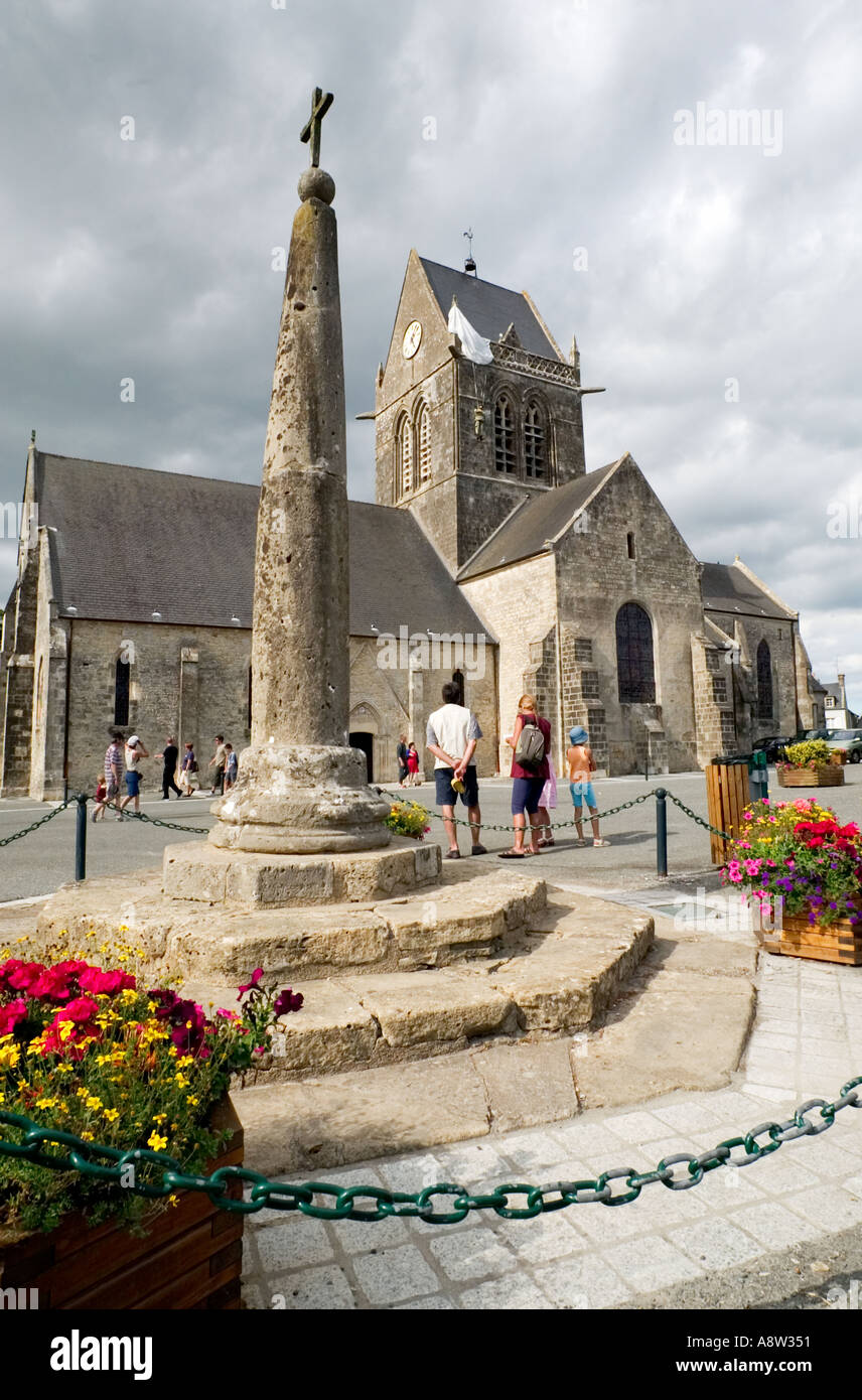Liberation Memorial and model of John Steele Paratrooper USA 82nd Airborne on church tower at St Mere Eglise, Normandy, Stock Photo