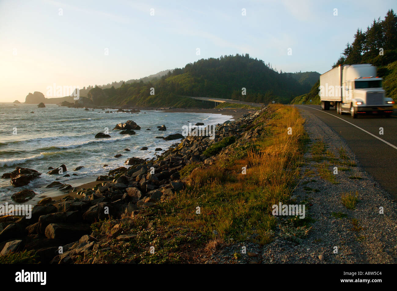 A truck on the Redwood Highway or Highway 101 passes by False Klamath Cove and Wilson Creek Del Norte Coast - Stock Image