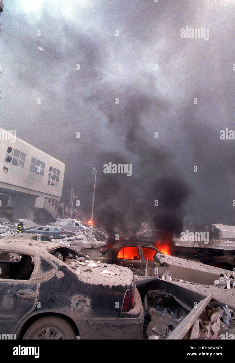 World Trade Center terrorist attack on September 11 2001 Debris and burning vehicles on West and Liberty Streets  - Stock Image