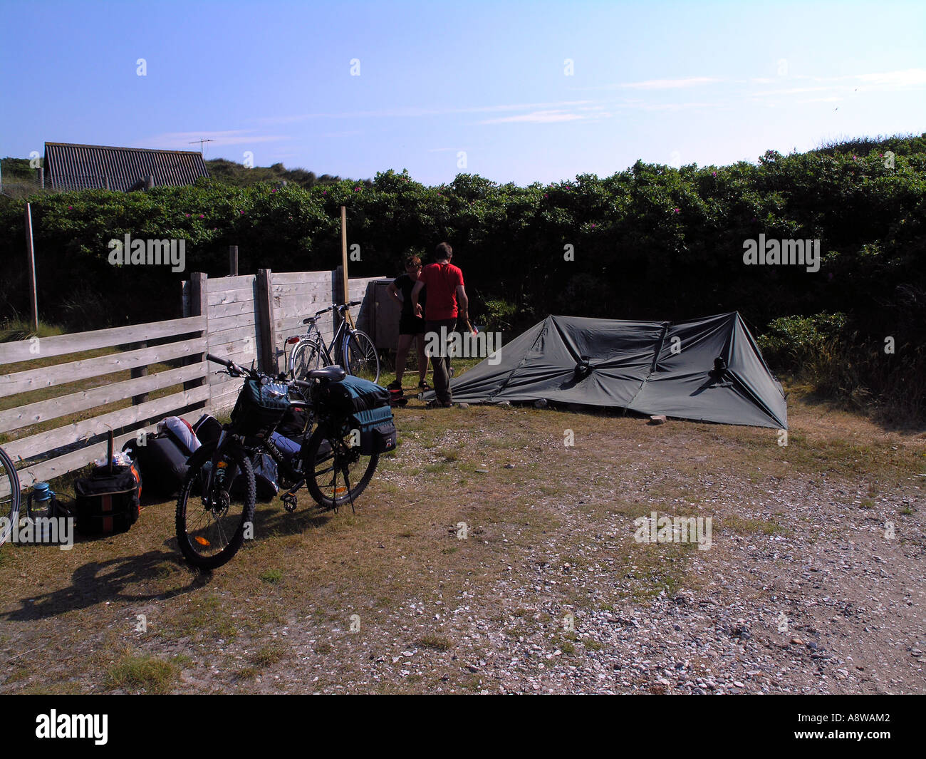 Bicycle vacation primitive lightweight tent made from ponchos - Stock Image