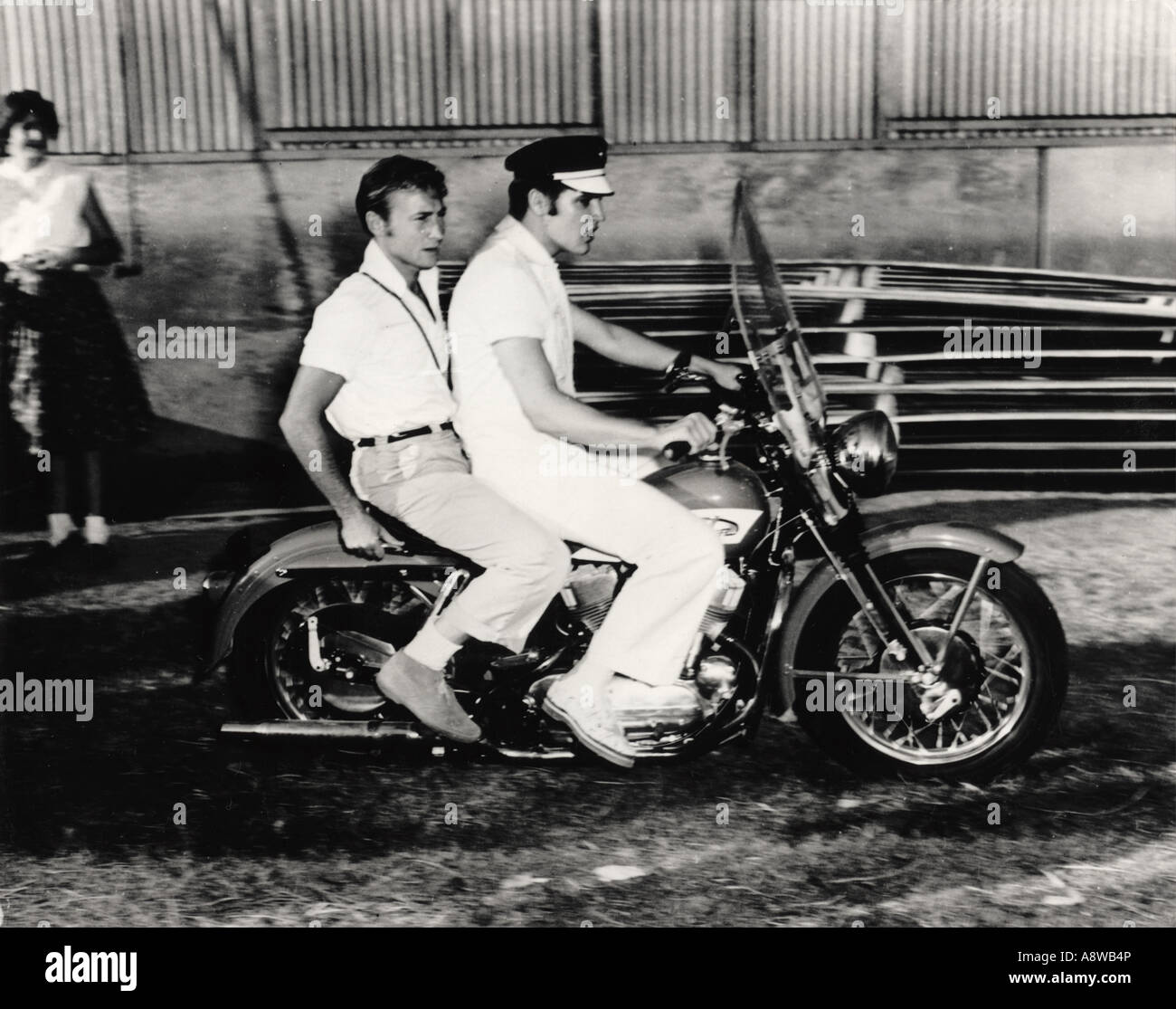 ELVIS PRESLEY  with Blue Moon Boys member Scotty Moore riding pillion about 1958 - Stock Image