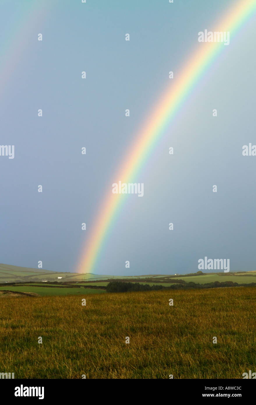 Rainbow over filds near Exmoor North Devon UK - Stock Image