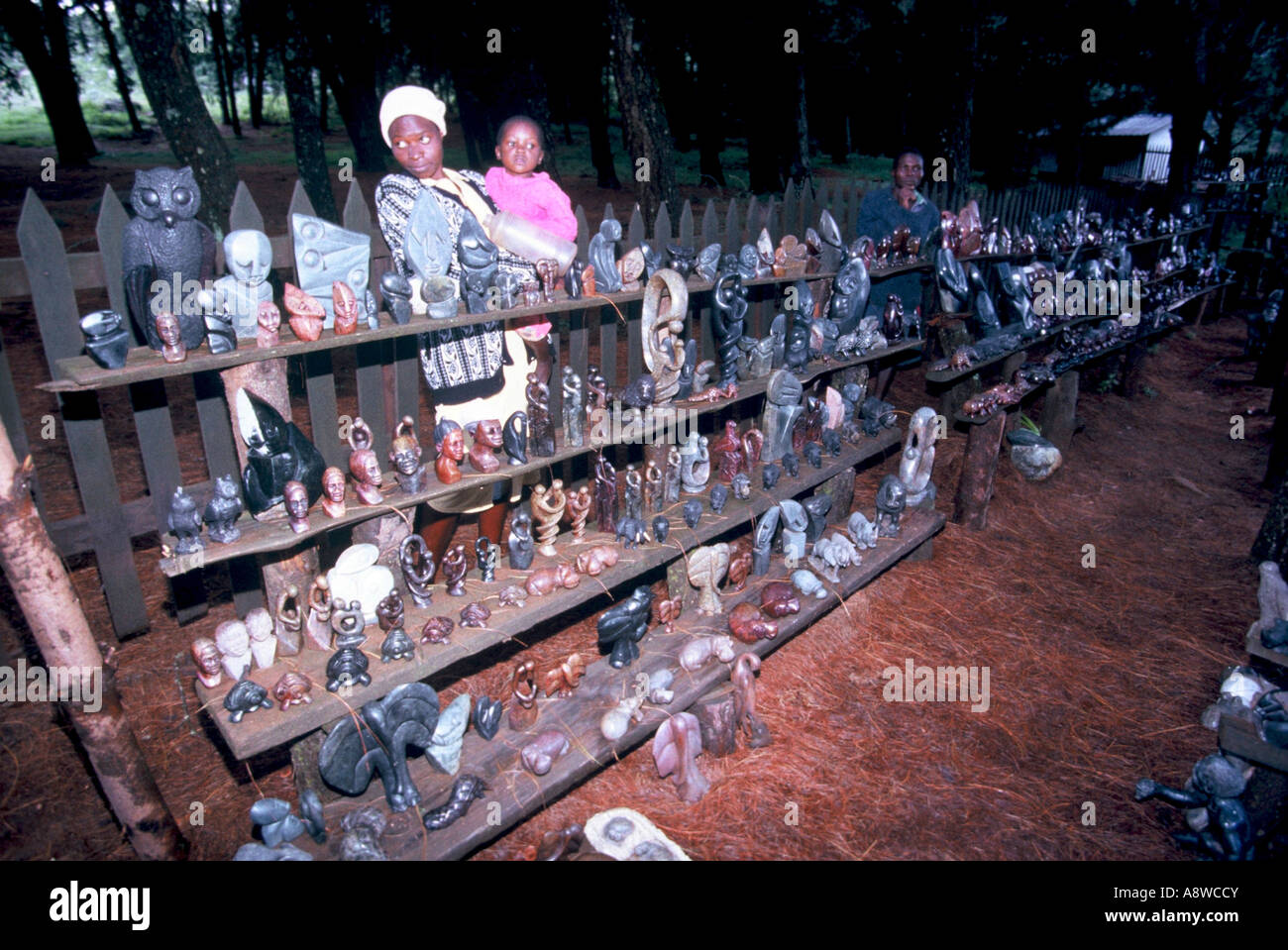 Soapstone curio carvings on sale to tourists - Stock Image