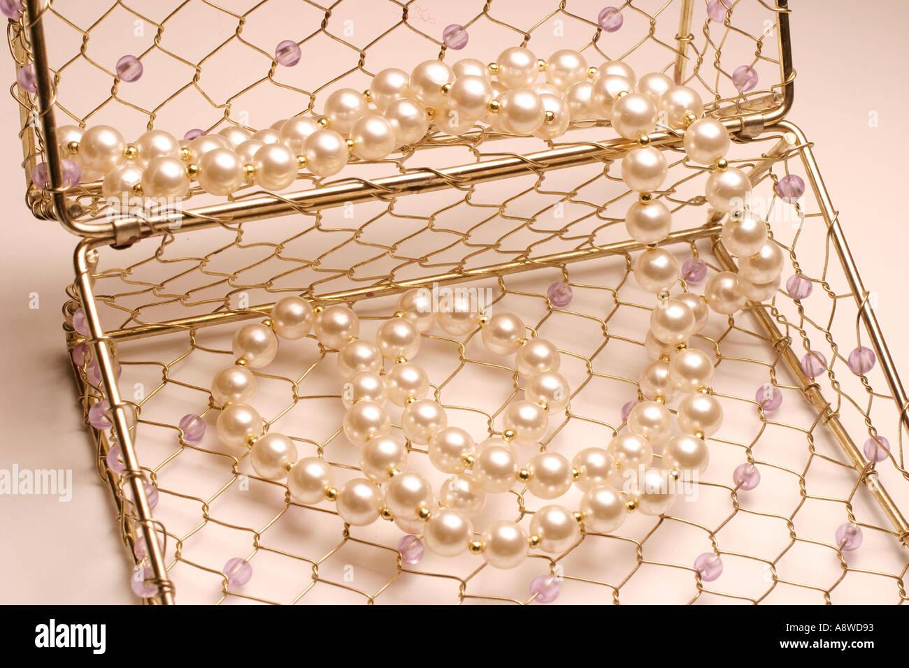 Pearl Necklace in Beaded Handbag - Stock Image