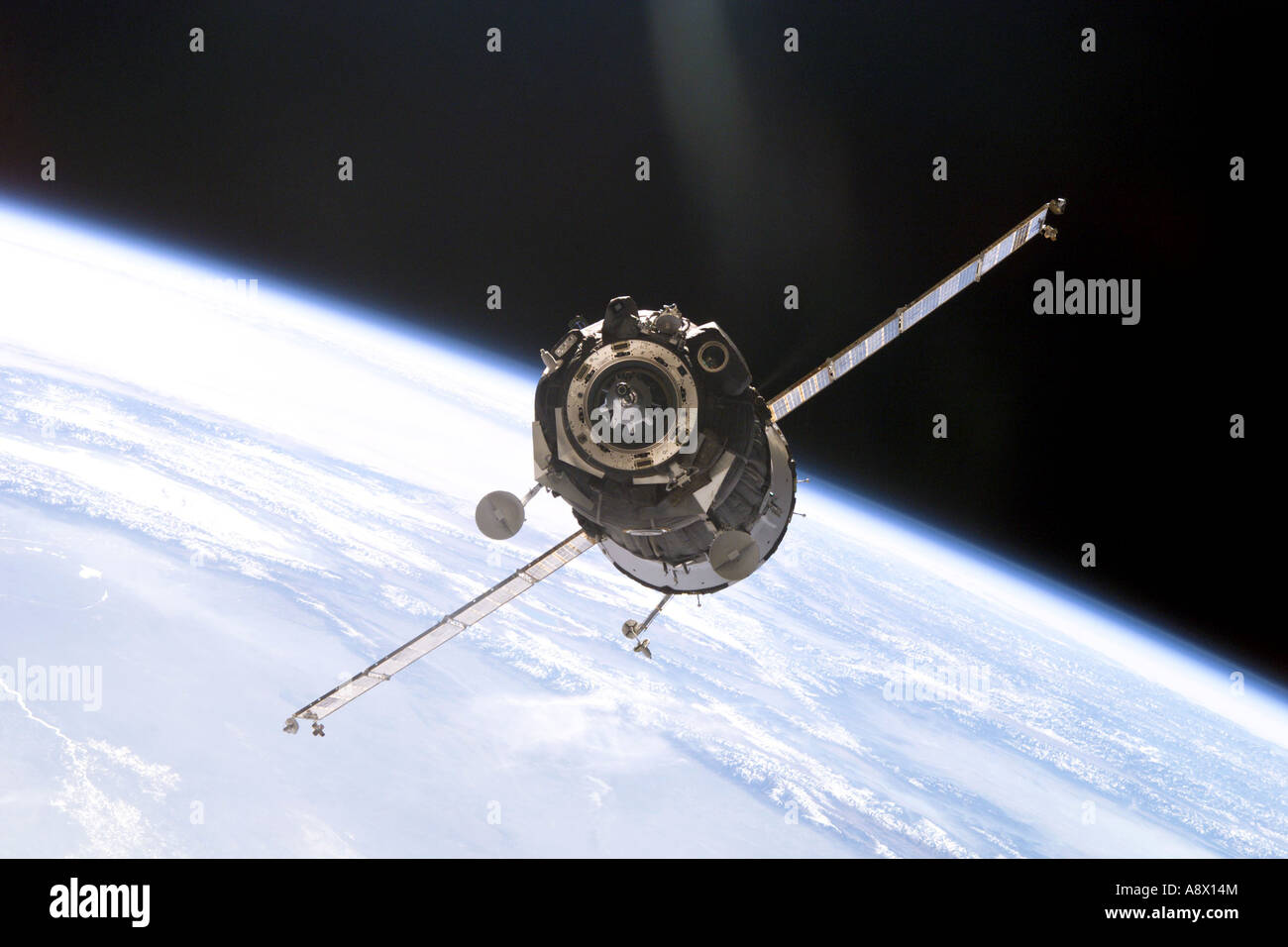 Soyuz spacecraft approaches the Pirs docking compartment on the International Space Station - Stock Image