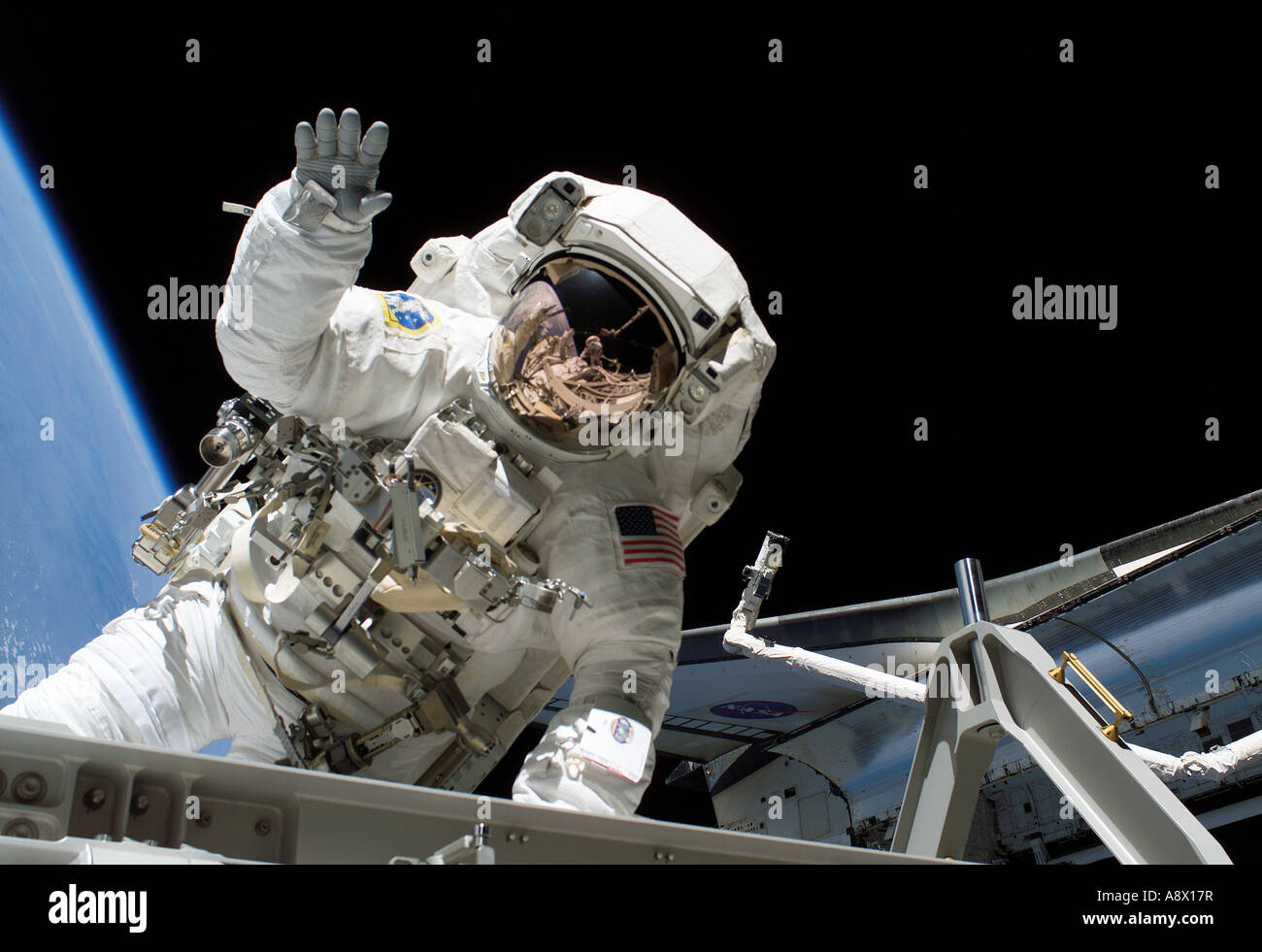 Astronaut Joseph R Tanner waves toward the camera during a ...