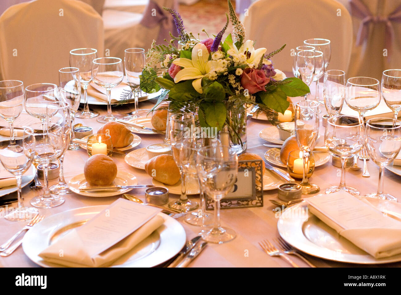 Formal wedding table setup with floral centerpiece. Copyright