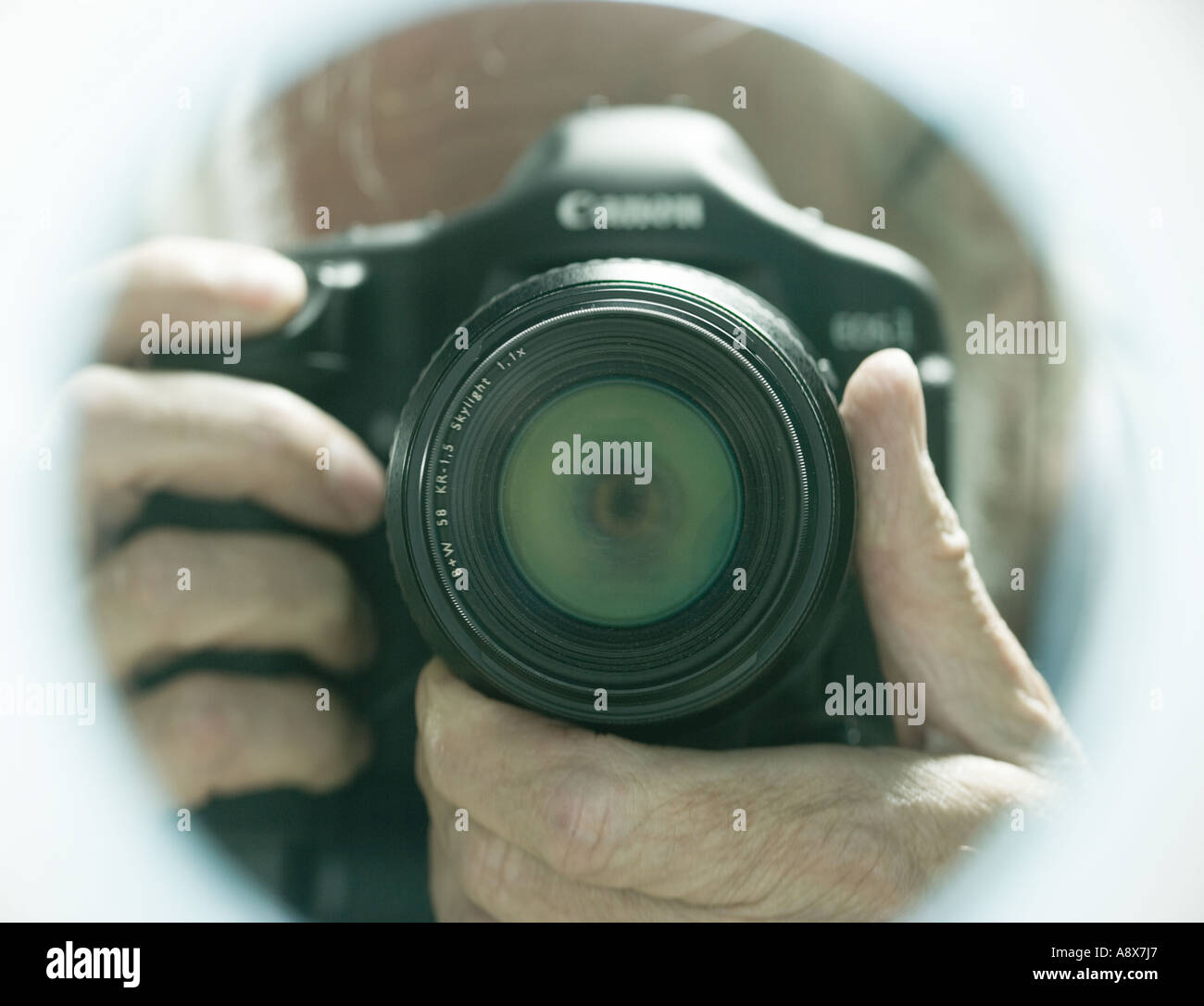 Digital camera pointing straight out of frame - Stock Image