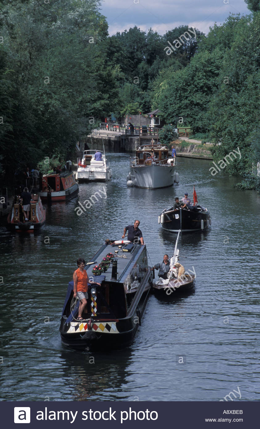 Narrowboats and launches on River Thames near Hurley Lock, UK - Stock Image