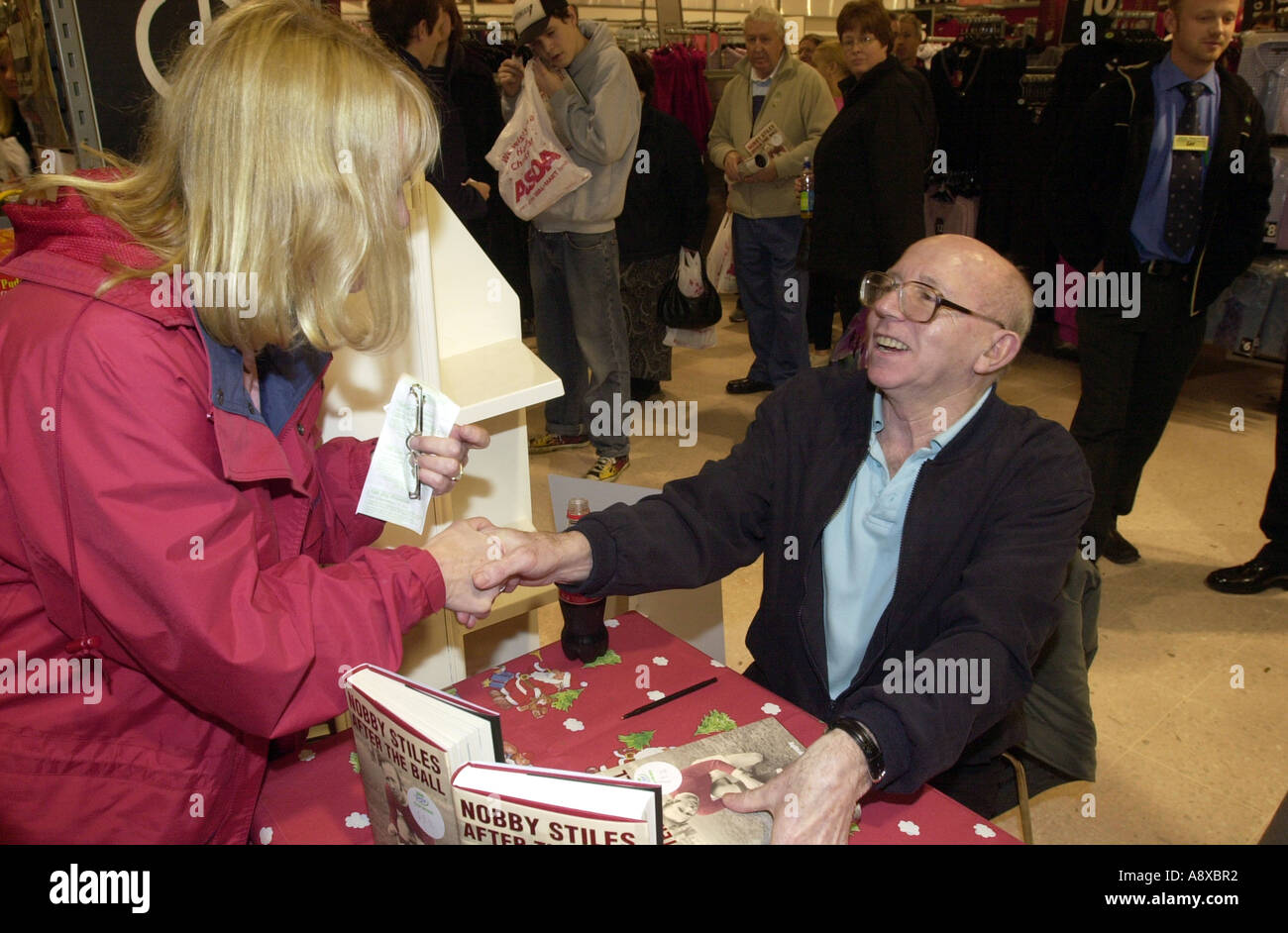 Nobby Stiles meets fans at a book signing UK - Stock Image