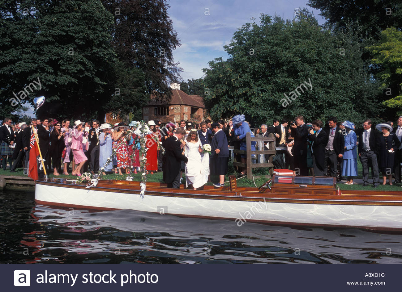 Newly married couple leaving Remenham s village church on a Regatta umpires launch for their reception in Henley, Stock Photo
