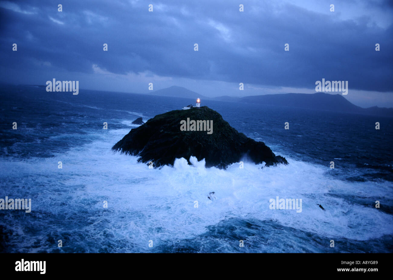 Black Rock lighthouse in gale force storm off the Atlantic coast of County Mayo, west Ireland. - Stock Image