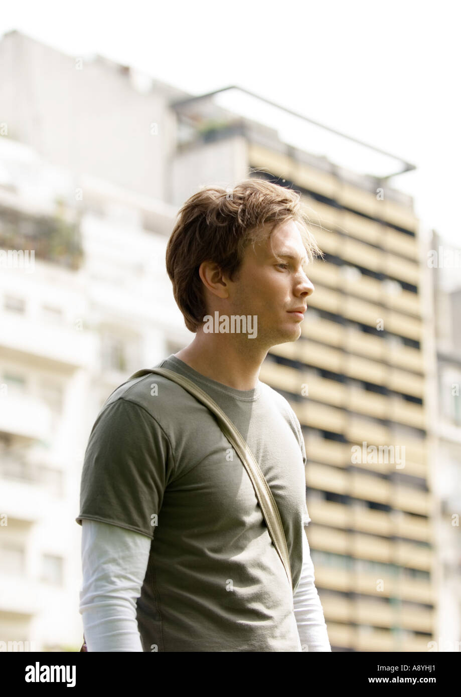 Young man in urban setting - Stock Image