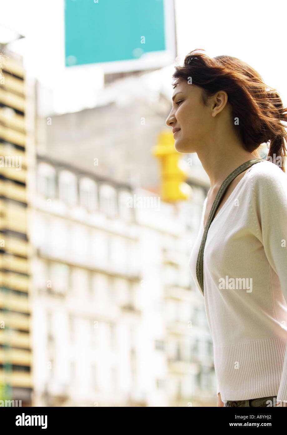 Young woman in urban setting - Stock Image
