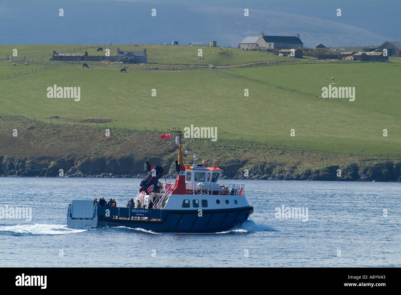 dh Graemsay island HOY SOUND ORKNEY Orkney Ferries MV Graemsay sailing passed shore ferry scotland islands boat Stock Photo