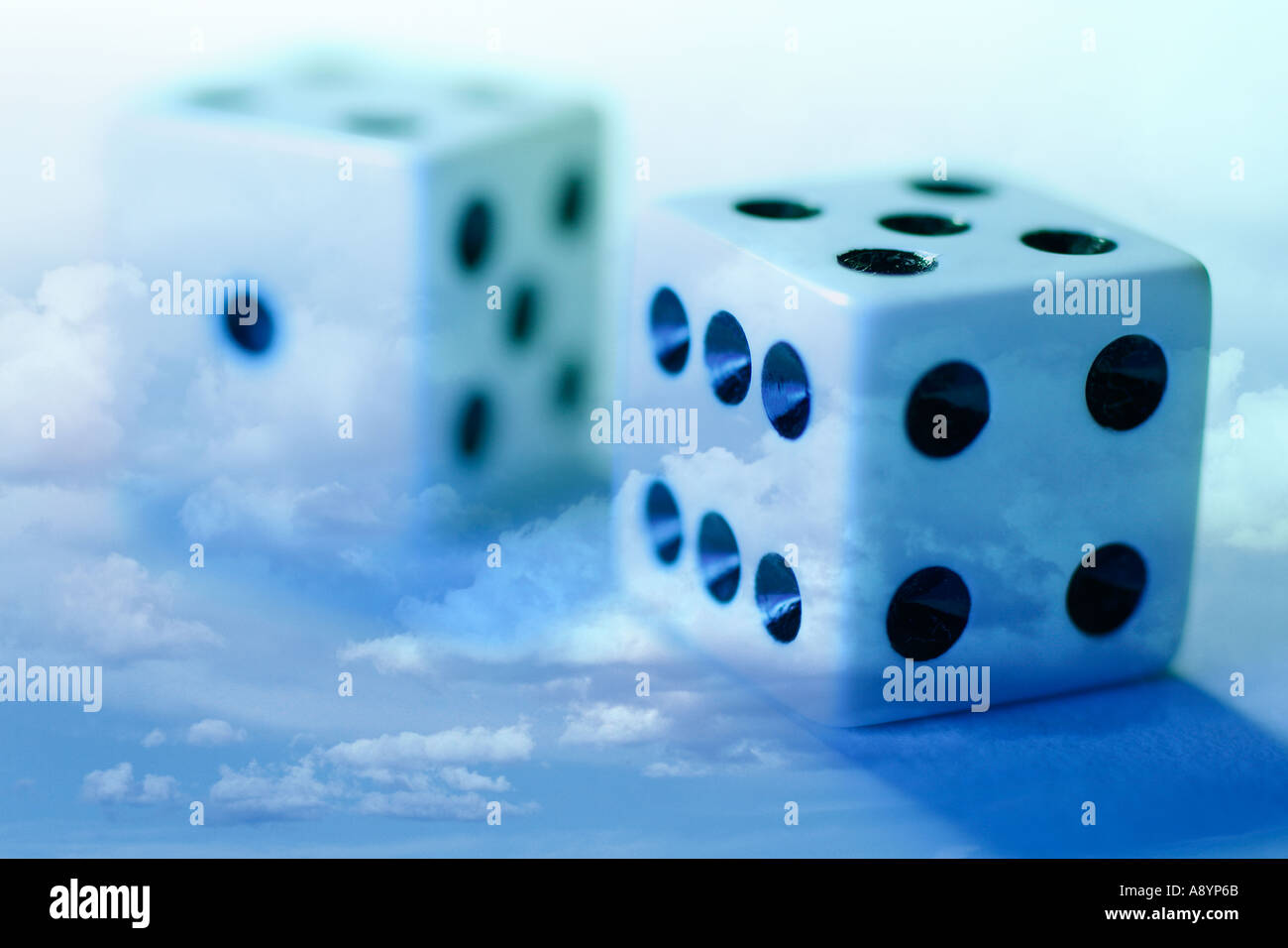 Dice and Clouds - Stock Image