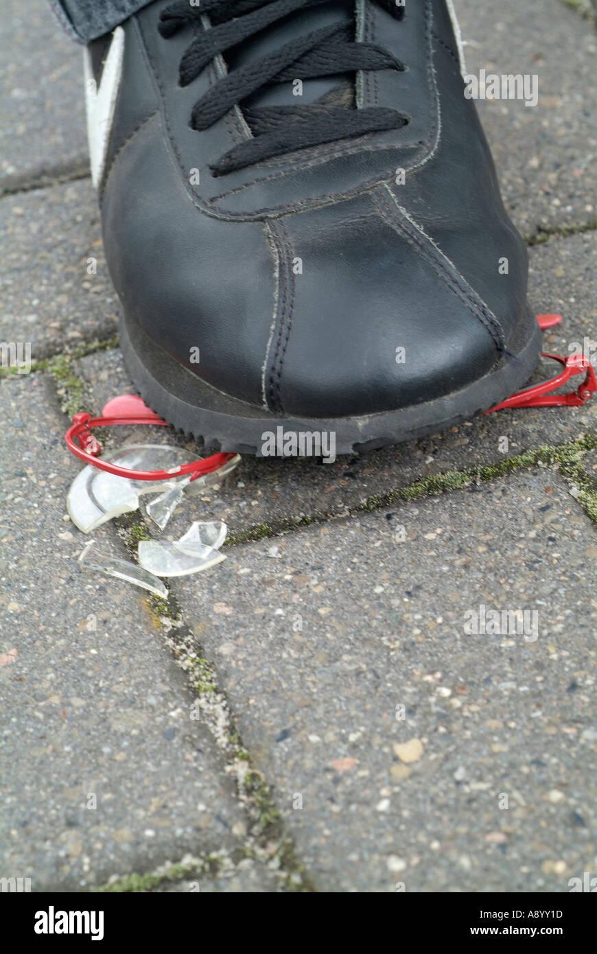 boy steps on eyeglasses Stock Photo