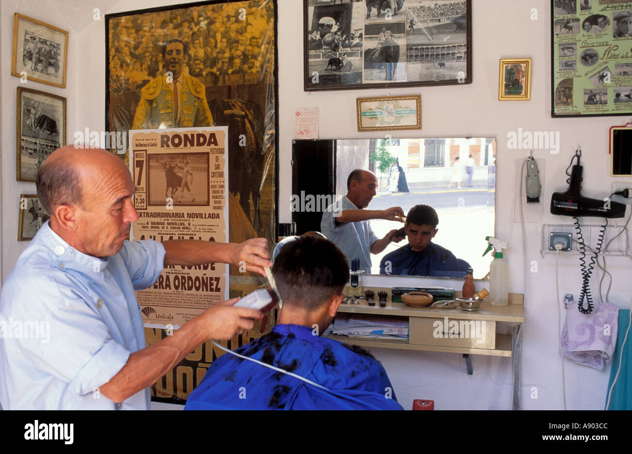 Barbers with bullfight posters Ronda Malaga Province Andalucia Andalusia Spain - Stock Image