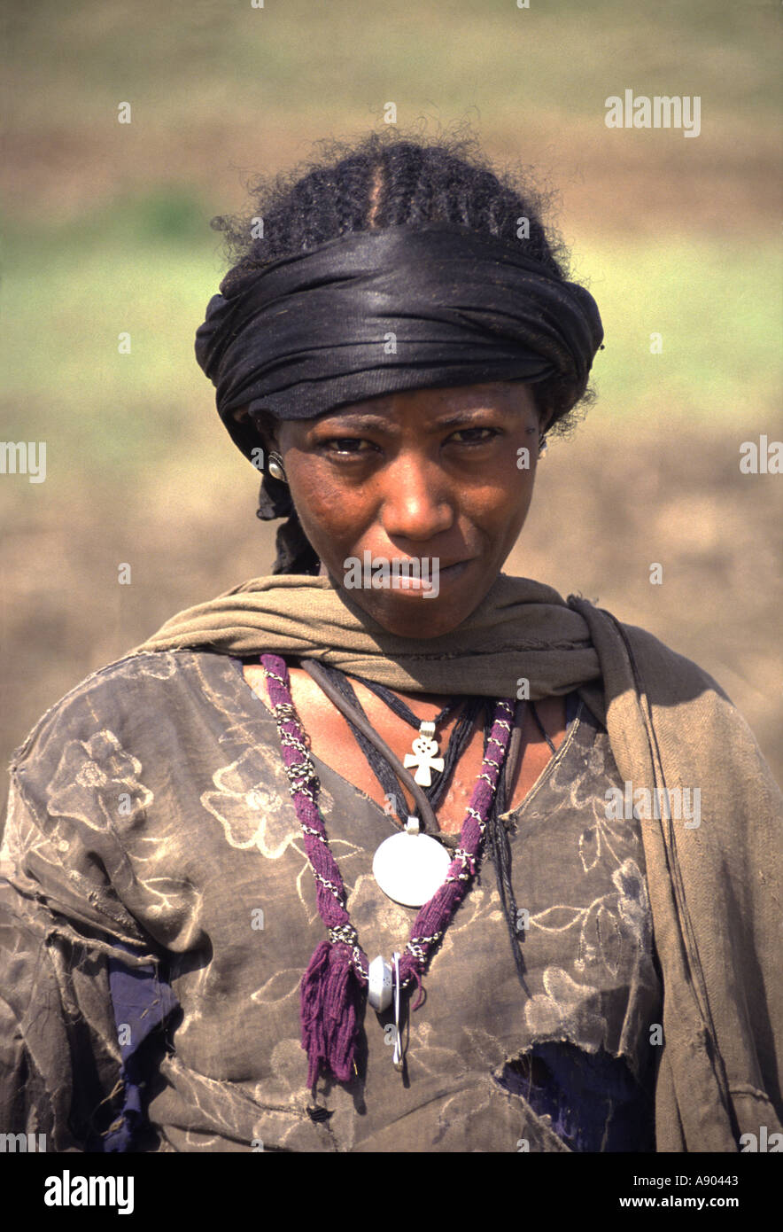 Woman with Silver Maria Teresa Thaler Pendant Welo Province Ethiopia Africa - Stock Image