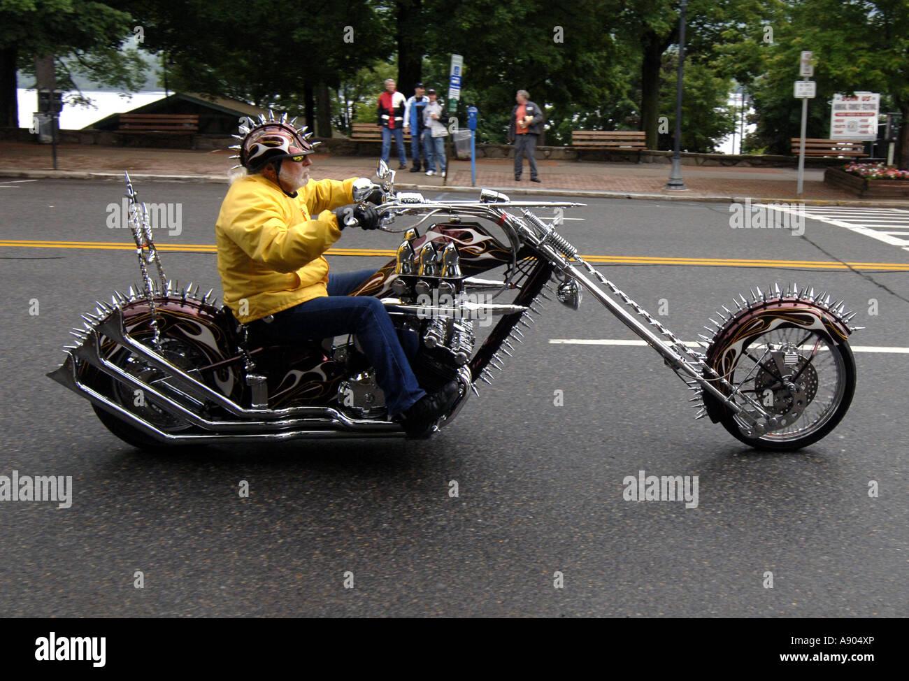 Lake George, NY. Americade Bike rally. Scott Ellis cruises Main Street on his custom chopper made from Honda 1981 - Stock Image