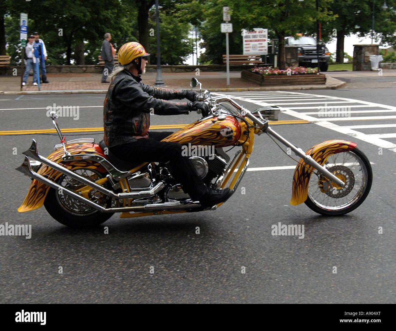Lake George, NY. Americade Bike rally. Cruising Main Street on a custom chopper - Stock Image