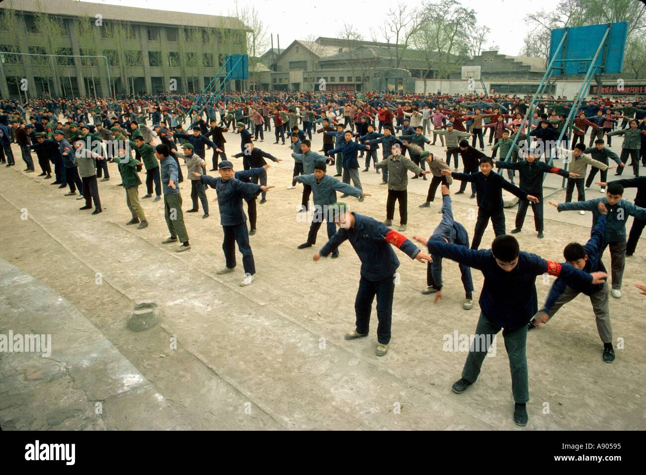 China during the Cultural Revolution Middle school students exercising outdoors - Stock Image