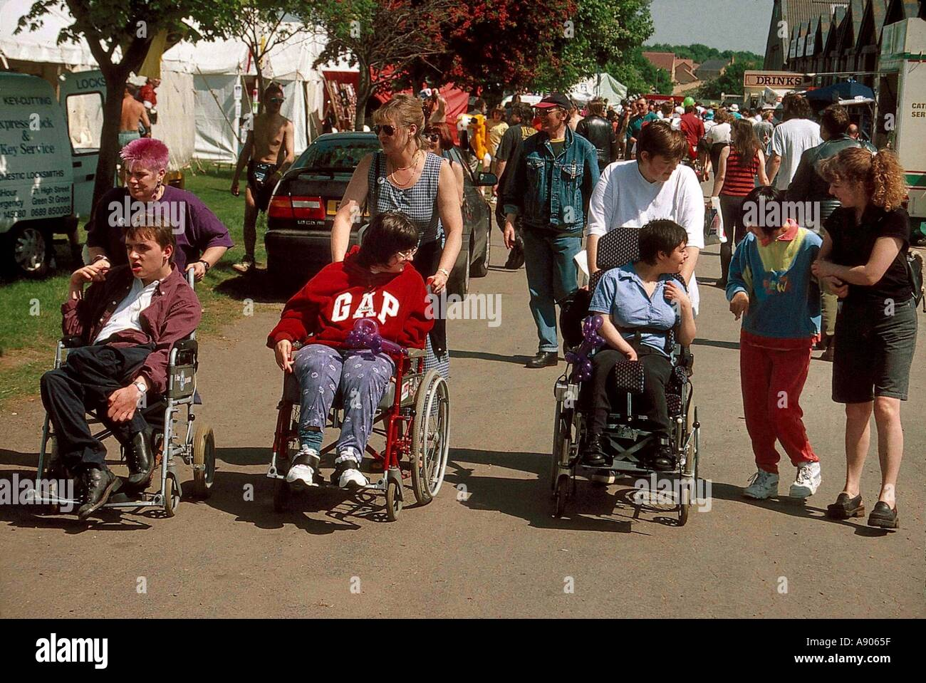 Disabled wheelchair bound young people at event - Stock Image